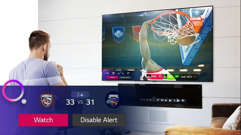 صفحه تلویزیون صحنه ای از یک بازی بسکتبال را با یک هشدار ورزشی نشان می دهد