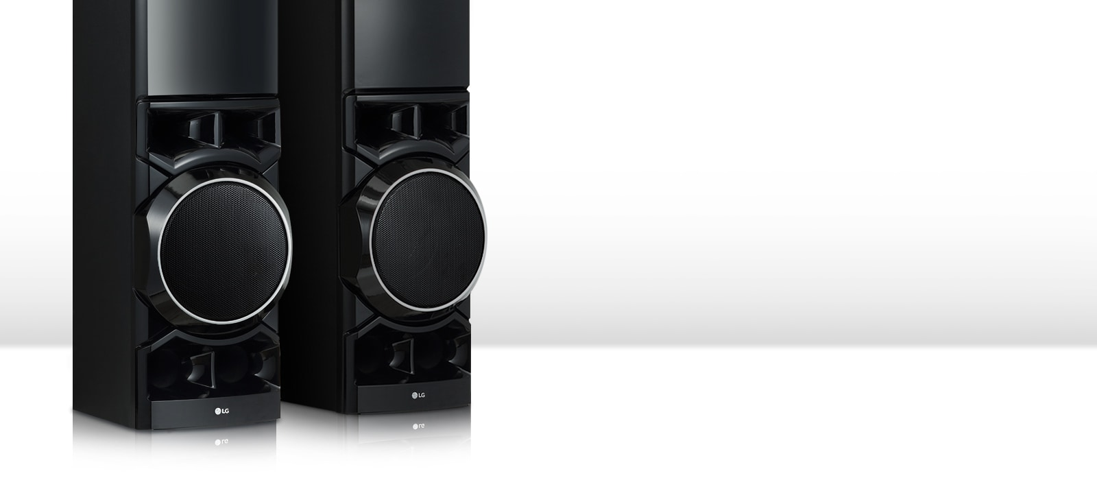 On the white living room, the lower part of the two tower speakers is seen big.