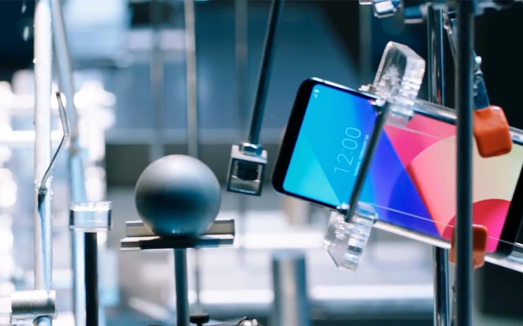 An image of lg g6 set in testing environment with lube goldburg installation