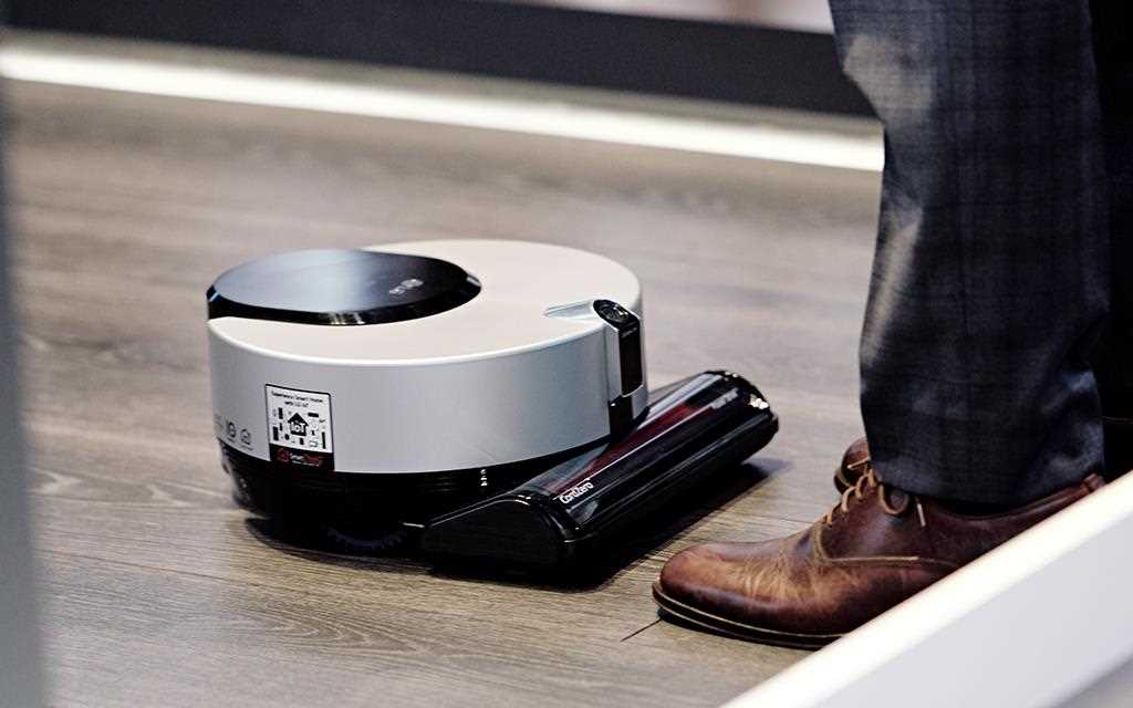 A photo of a lg robot vacuum cleaner performing at lg iot zone at berlin ifa 2017.