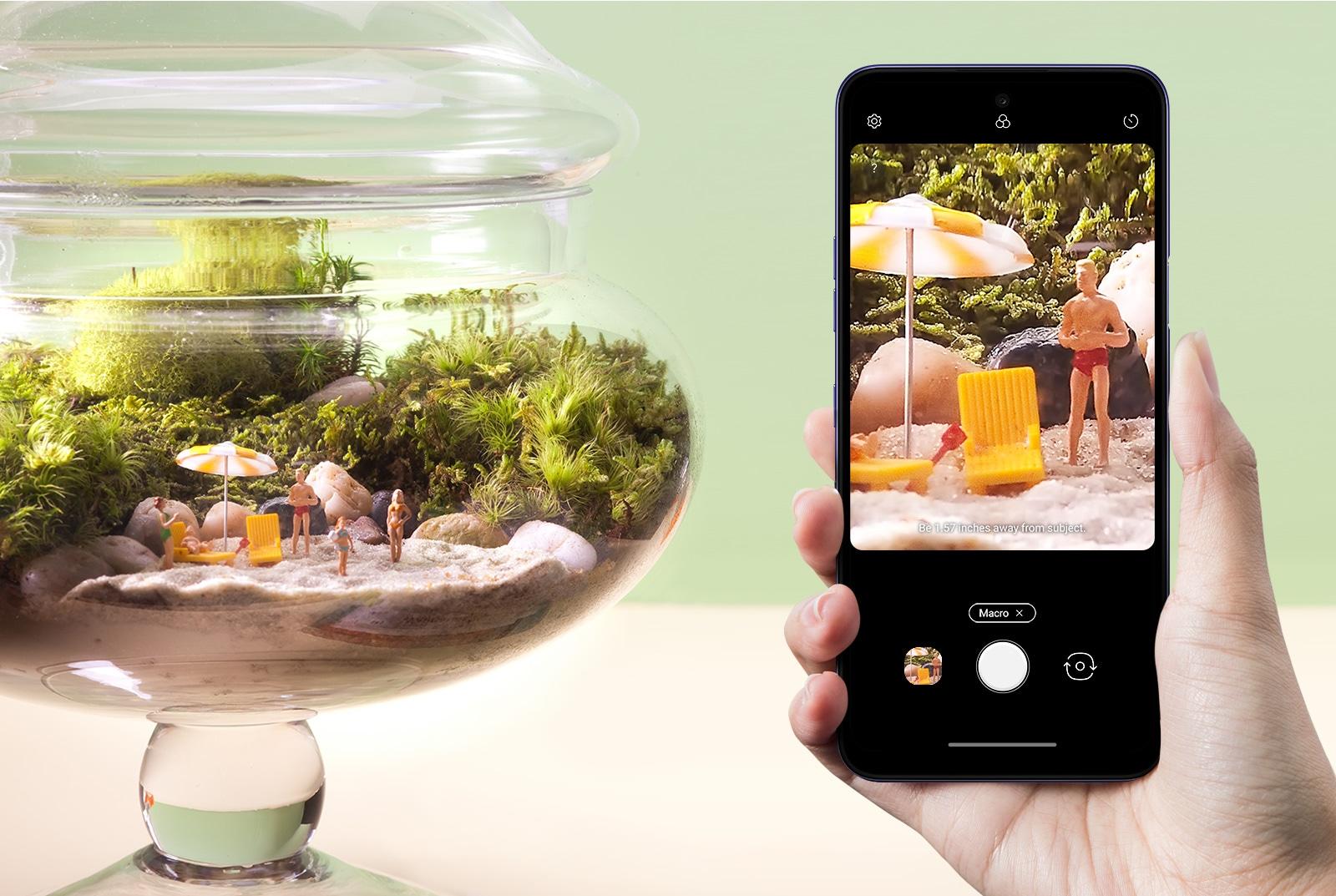 Smartphone shooting miniatures in fishbowl.