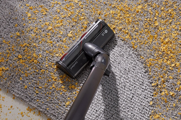 Three images in line: the first shows the vacuum vacuuming dirt from a hard surface, second shows vacuuming chips from a carpet, and the third shows the Power Punch on bedding.