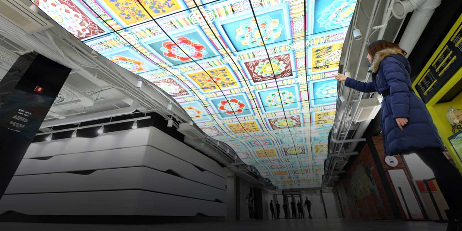 Woman Looking Up at Ceiling Digital Signage Display