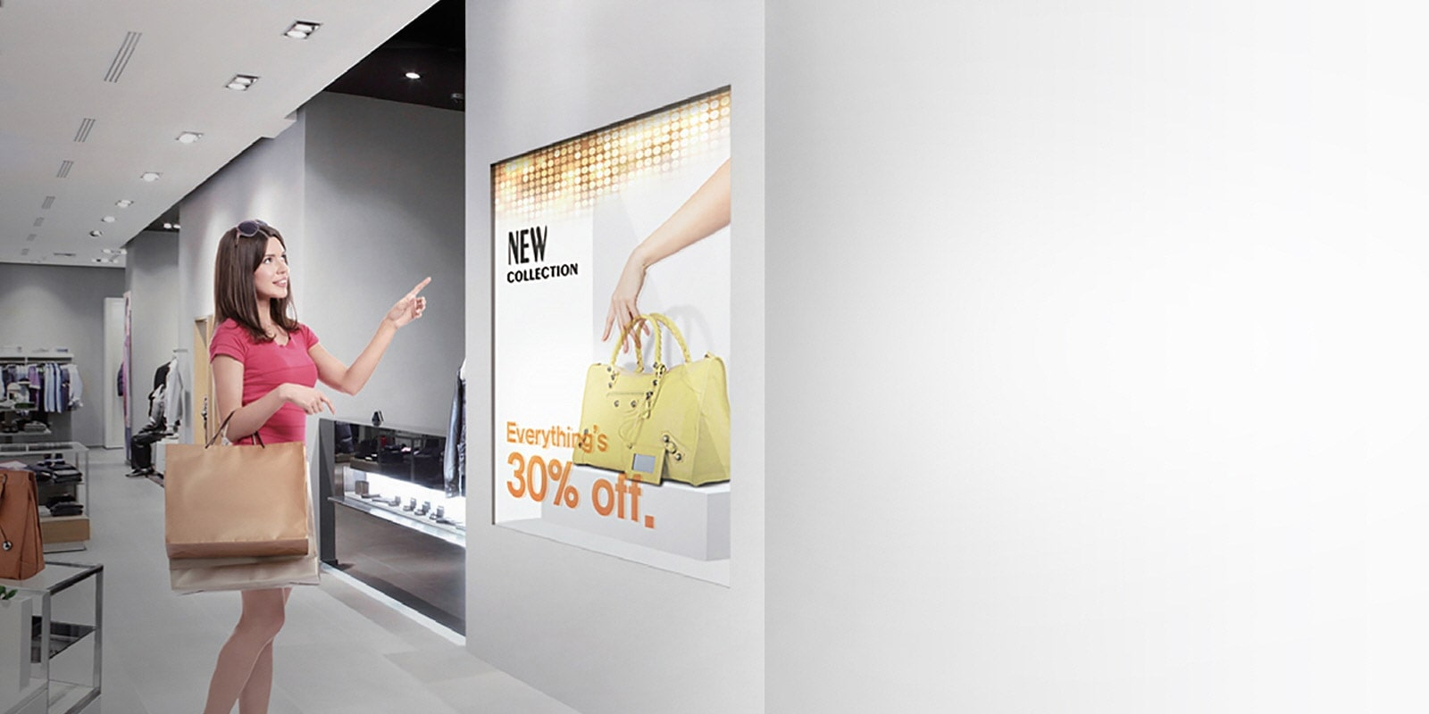 Woman with Shopping Bags Looking at LG Commercial TV Display