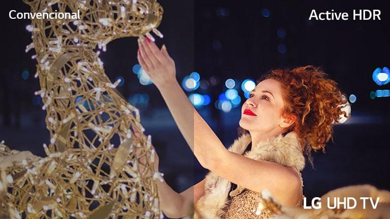 La escena de una mujer tocando una exposición cubierta de pequeñas bombillas se divide por la mitad para comparación visual. En la imagen hay textos de Convencional, en la parte superior izquierda, HDR activo en la parte superior derecha y el televisor LG UHD en la parte inferior derecha.