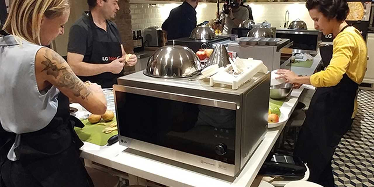 A image of a group of people cooking with LG NeoChef microwave at the competition