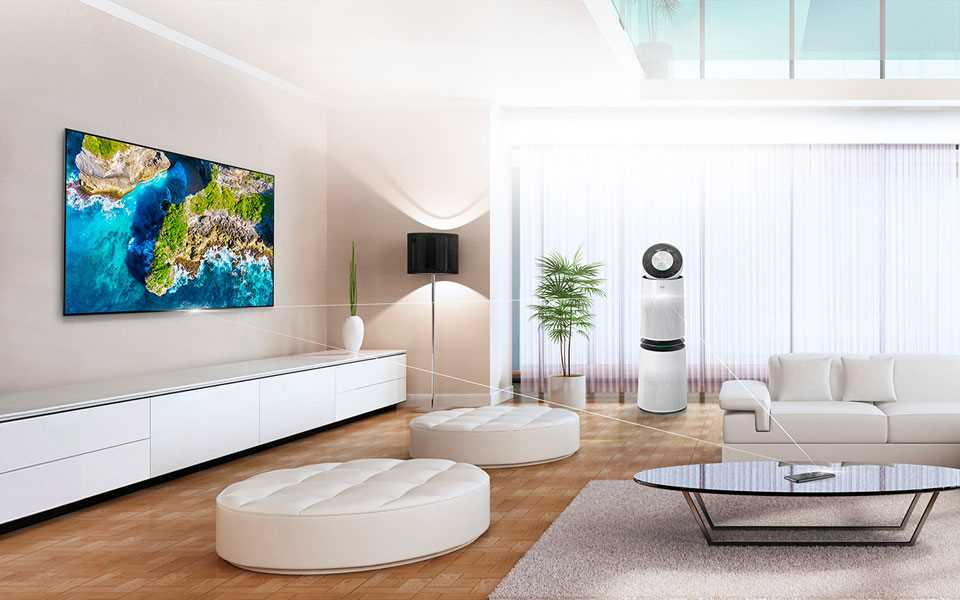 An LG PuriCare™ Air Purifier and OLED TV on display in a living room with seating.
