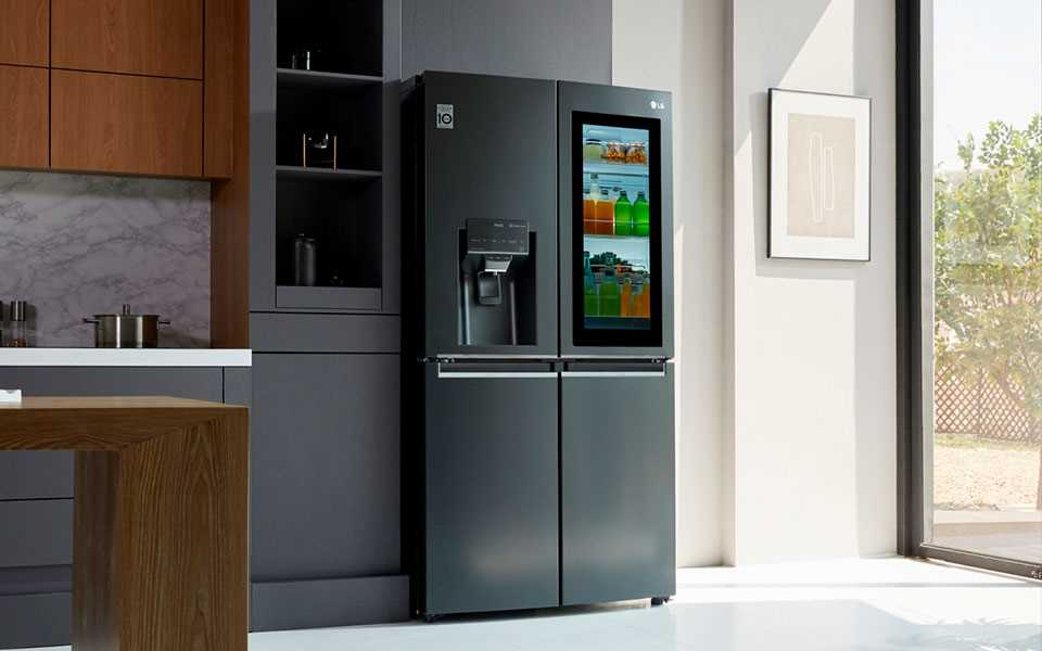 The LG Instaview Door-In-Door refrigerator with its contents visible through the mirrored glass panel.