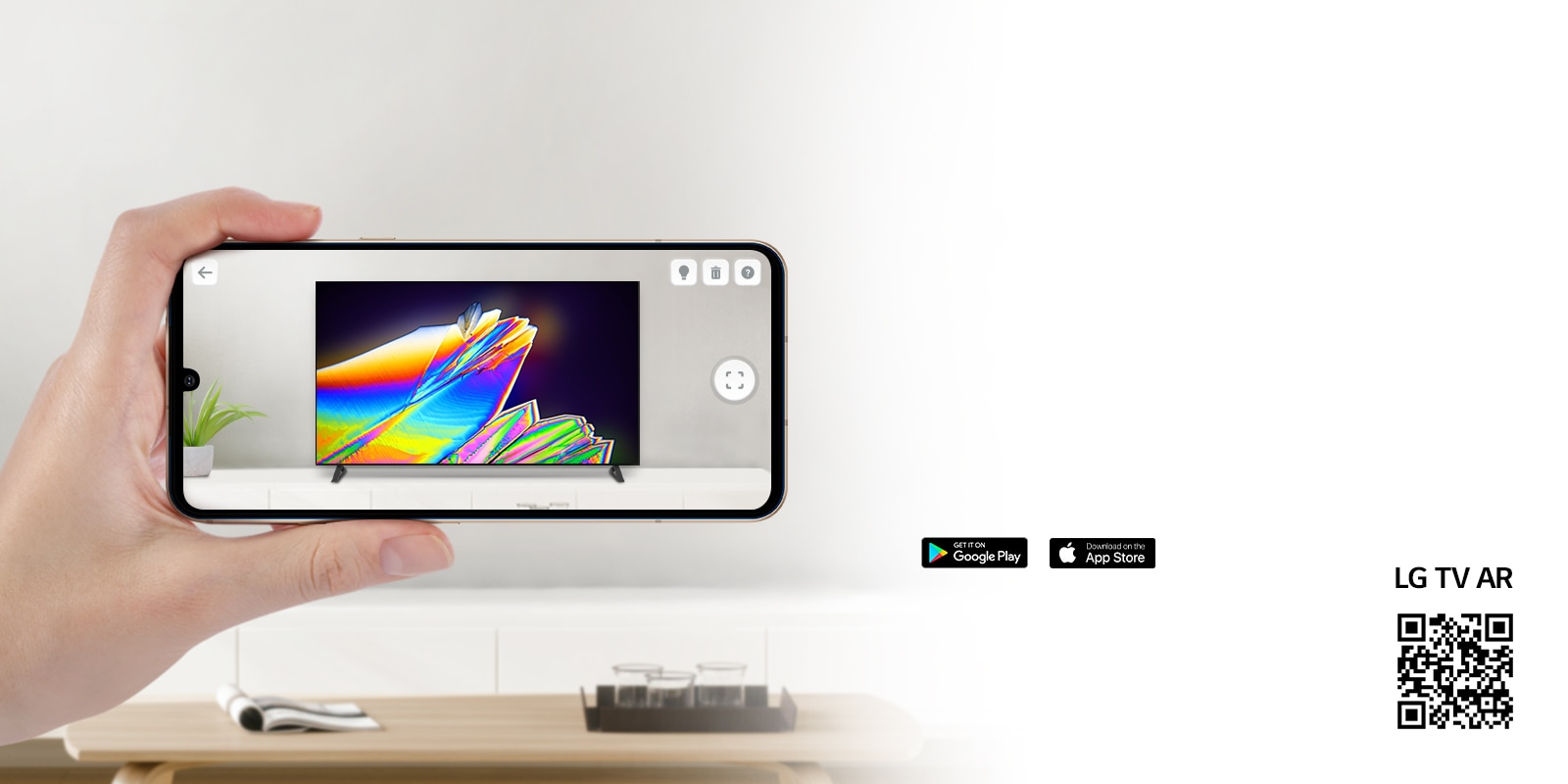 A person using LG TV AR app on a phone and a QR code which links to LG TV AR (http://www.lgtvism.com/lgtvar)