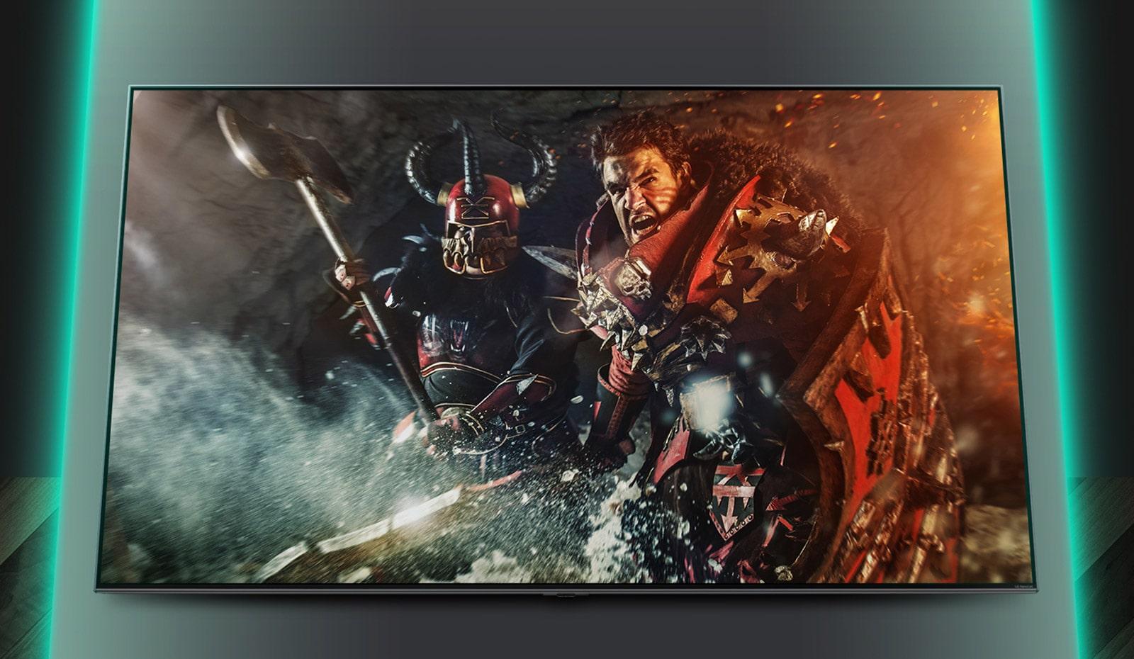 La pantalla del televisor muestra la escena del juego de batallas.