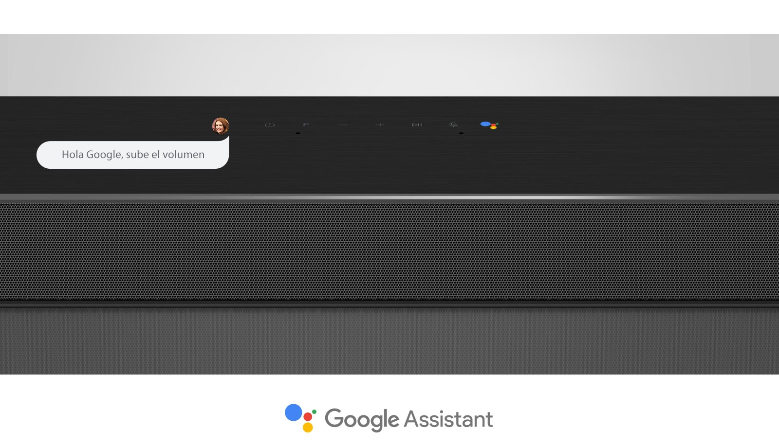 Primer plano de la sección media de la barra de sonido LG con controles de audio y el logo Google Assistant. Con el comando de voz de Google para subir el volumen.
