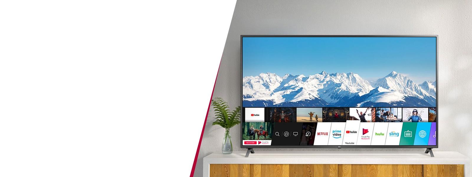 Téléviseur UHD LG UN85 positionné sur un meuble TV