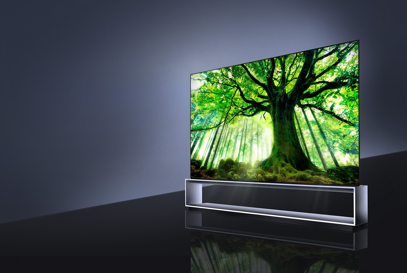 Side view of LG SIGNATURE OLED TV Z9 with the screen filled with a big tree
