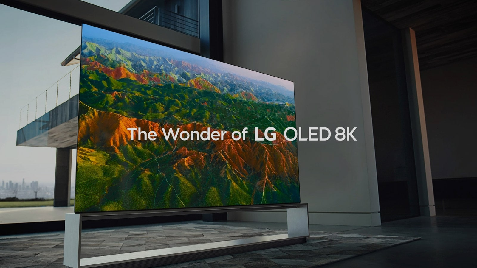 Side view of LG SIGNATURE OLED TV Z9 with the screen filled with wide and broad mountain range