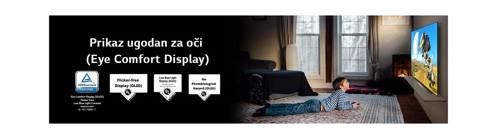 Prikaz s bočne strane dječaka koji leži i gleda TV naziva Eye Comfort Display