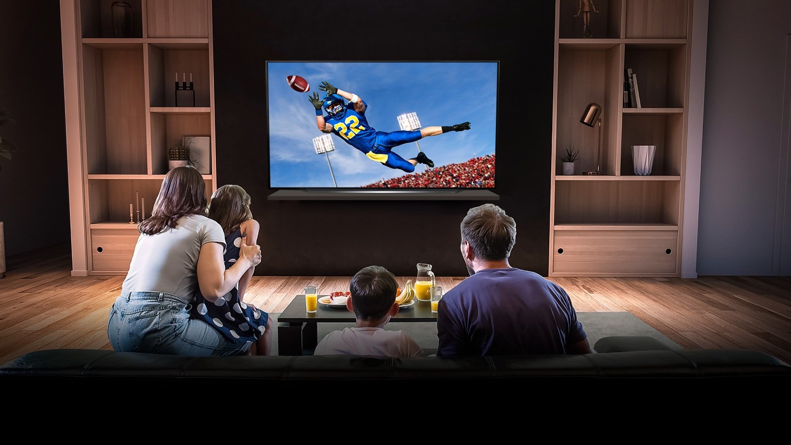 People watch an American football game on TV in the living room
