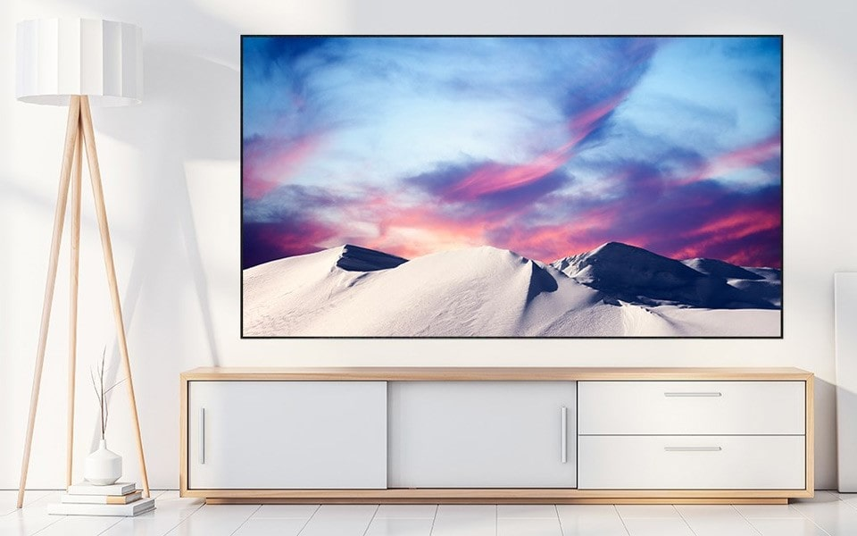 LG's 8K TV sits in the living room, showing beautiful images of stunning places around the world | More at LG Magazine
