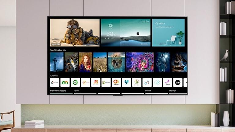 Layar TV yang menampilkan home screen dengan desain baru beserta konten dan saluran yang dipersonalisasi