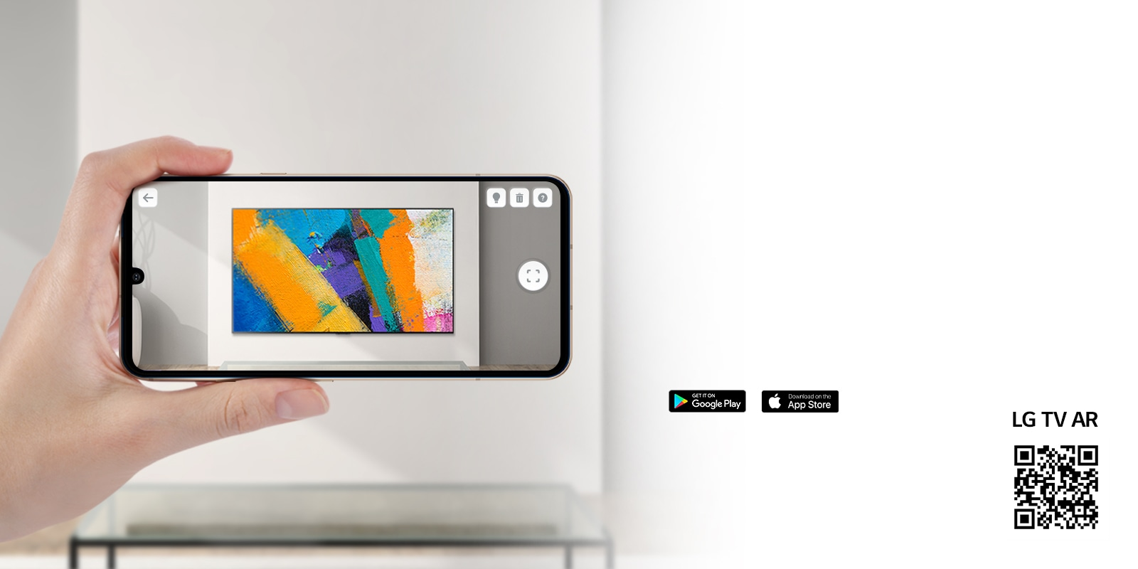 A person using LG TV AR app on a phone and a QR code which links to LG TV AR(http://www.lgtvism.com/lgtvar)