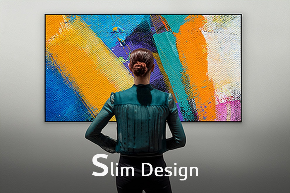 """A back view of a woman watching a Gallery Design TV, labeled""""Slim Design"""""""