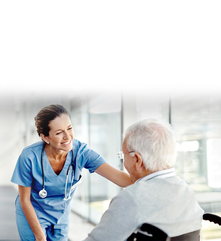 An image of a nurse smiling to a patient.