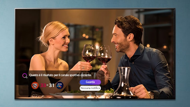 A man and woman make a toast on a TV screen as sporting event notifications pop up