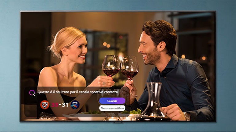 A man and woman make a toast on a TV screen as Sports Alert notifications pop up