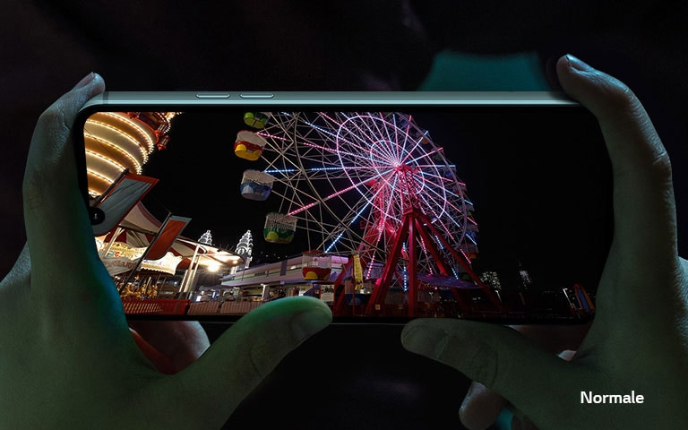 Video of the nightly amusement park playing on the screen of smartphone.