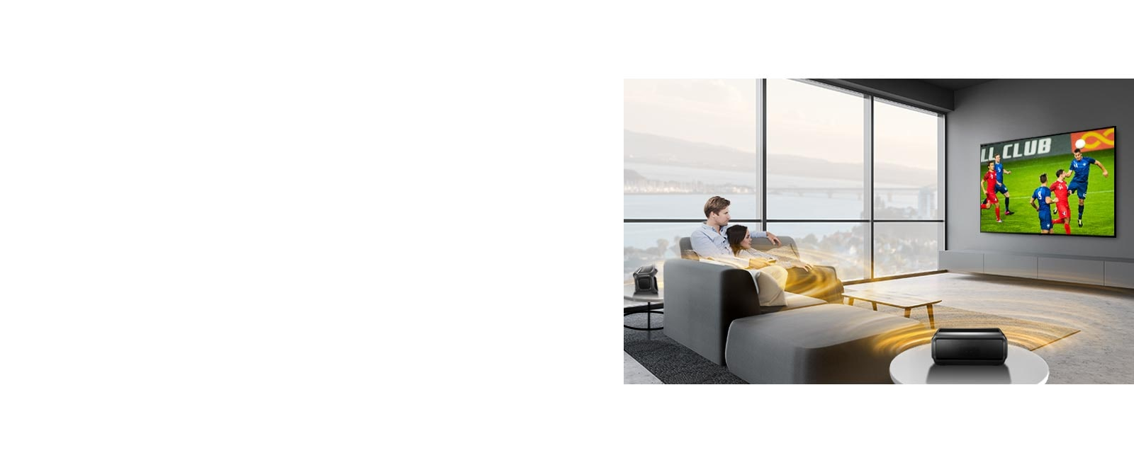 A man and women watching sports game on TV in the living room with Bluetooth rear speakers