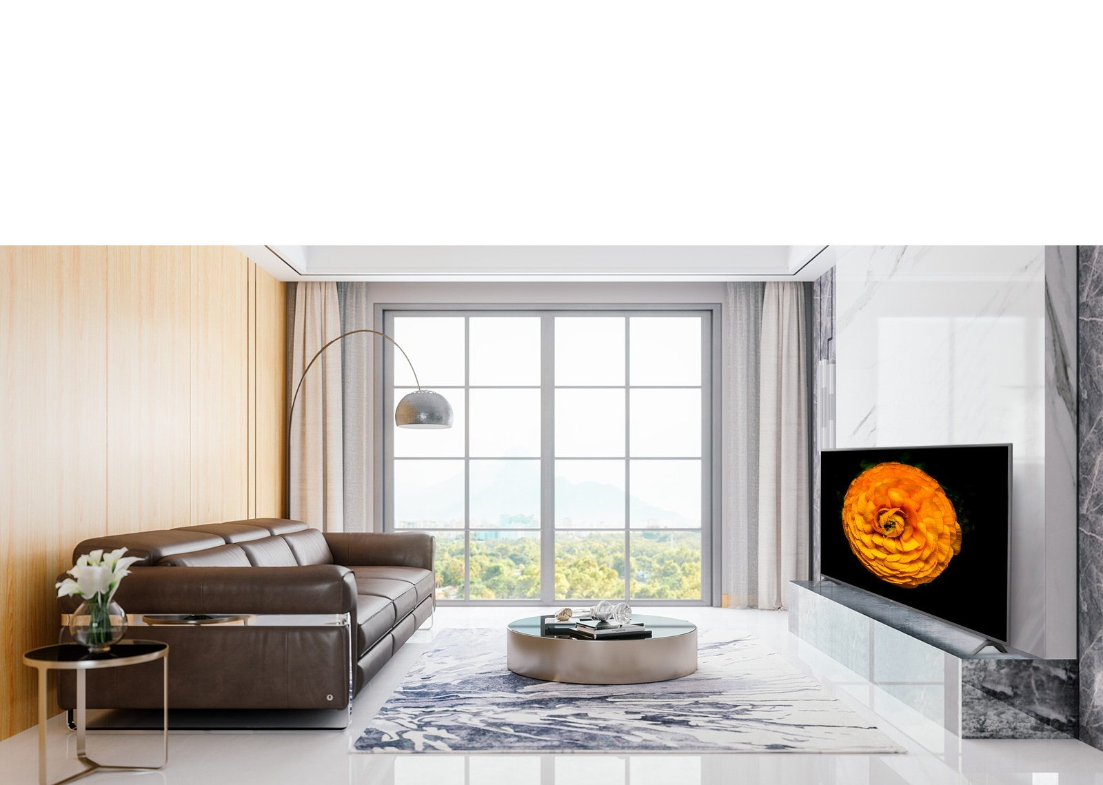 LG UHD TV, located on the wall in a living room with the minimal interior. Image of a flower is shown on the TV screen.