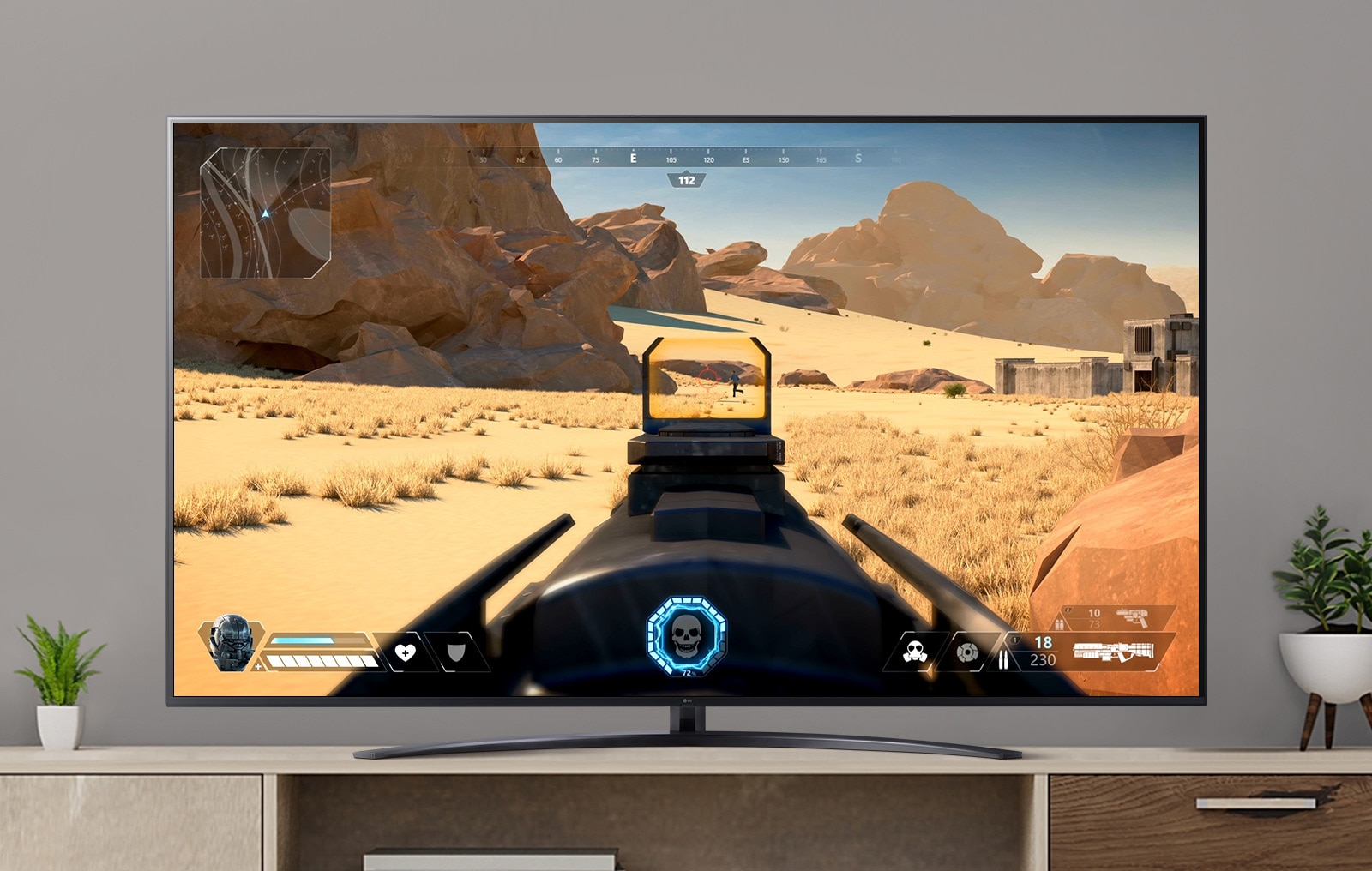 A video is shown on a TV screen with an FPS game in which a gun is fired at an enemy. (play video)