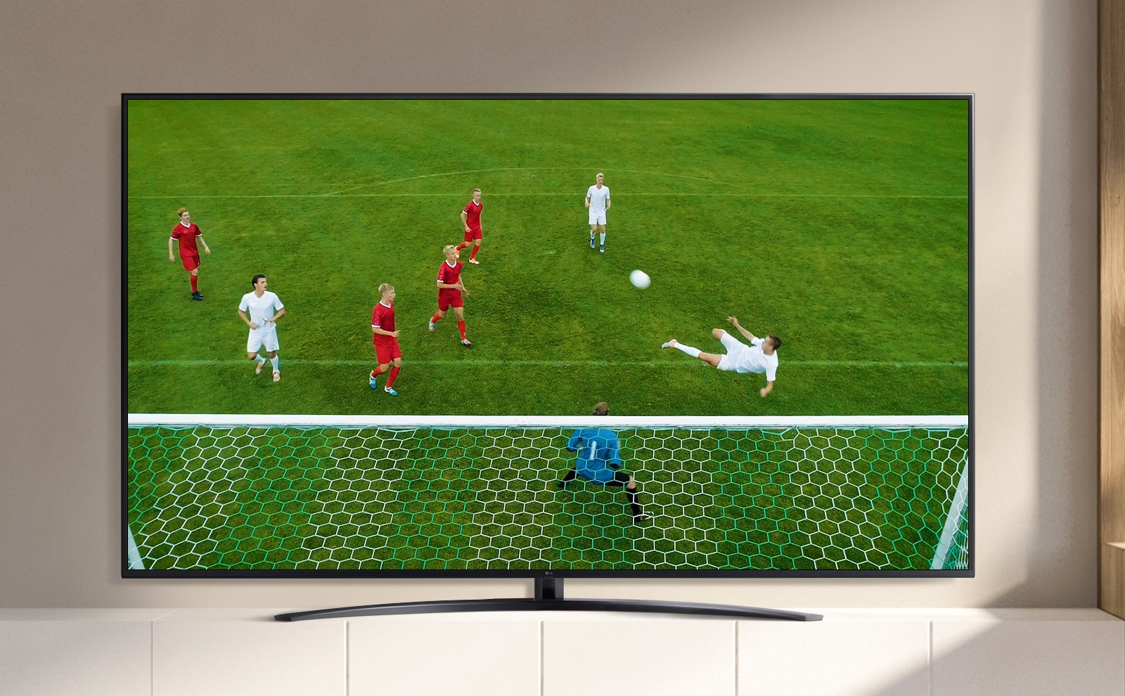 A video is shown on a TV screen in which a football player scores a goal during a football match. (play video)