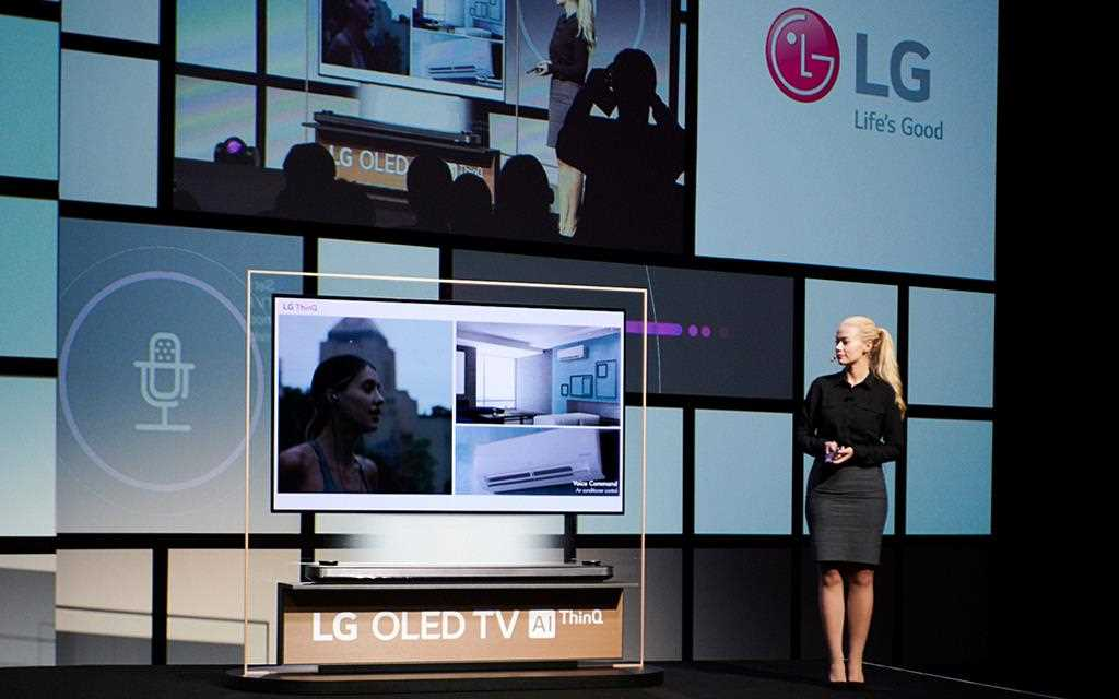 A woman demonstrating artificial intelligence within the LG OLED TV during LG IFA 2018 keynote speech.