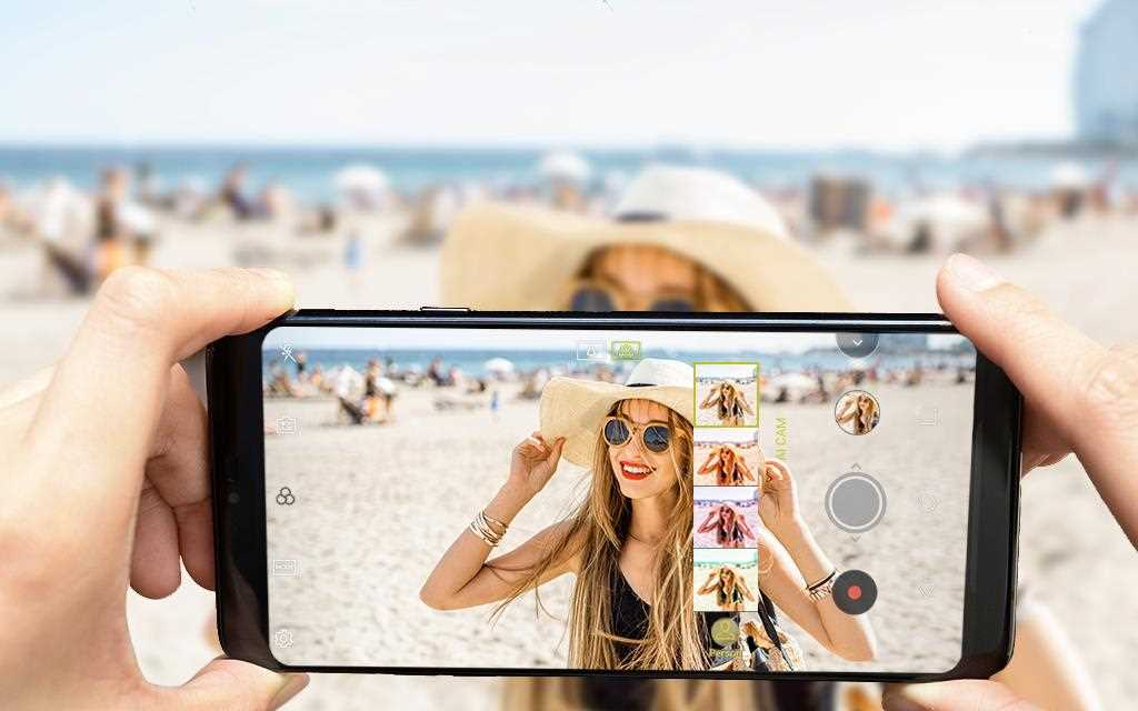 A girl is talking a picture in the beach with using AI cam feature of LG G7 ThinQ.
