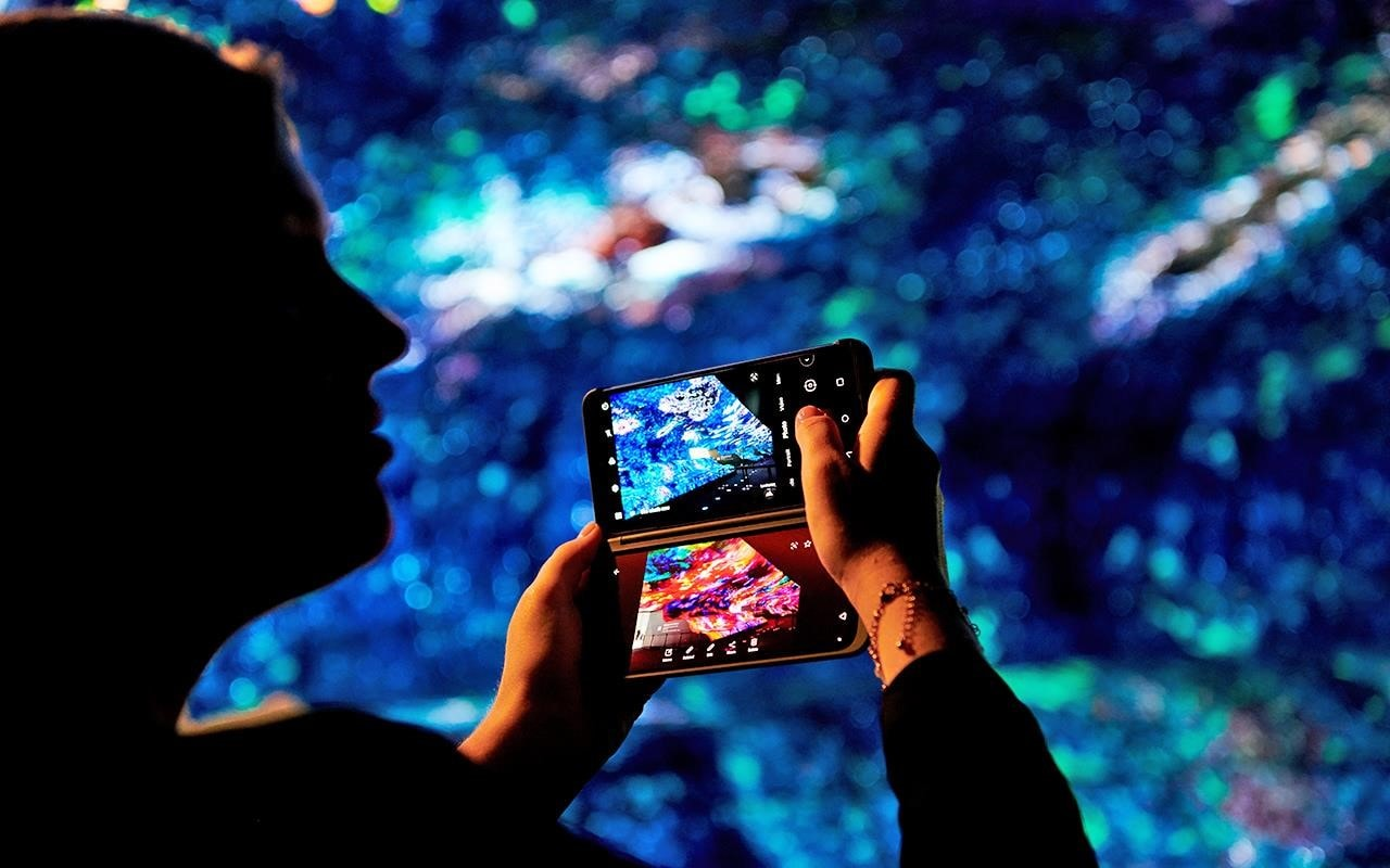 An IFA visitor takes a shot of the OLED Falls at LG's IFA 2019 exhibition | More at LG MAGAZINE