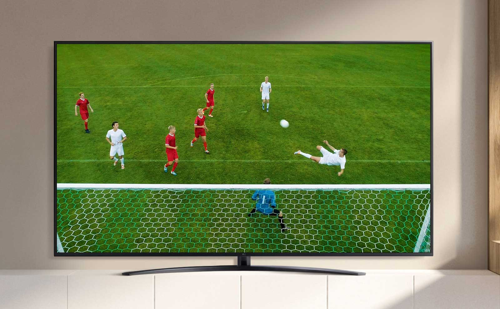 A TV screen playing a video of a soccer player making a goal during a soccer game. (play the video)