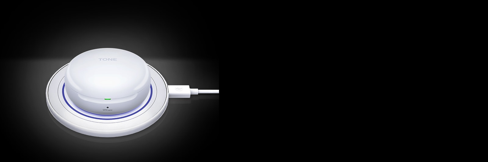 An image of a white LG TONE Free FN6 opened up charging on a white wireless charging pad.