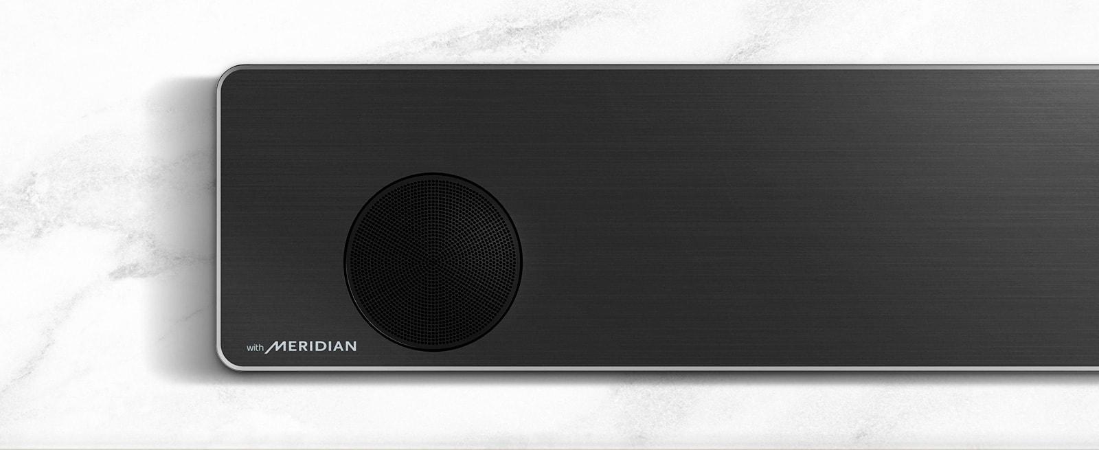 Close-up of the left side of LG Soundbar with Meridian logo on the bottom left corner.