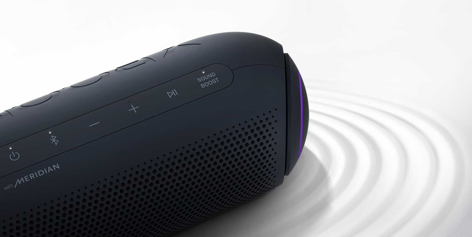 On a white background, LG XBOOM Go faces the upper right with purple lighting, there is a ripple effect under the product.