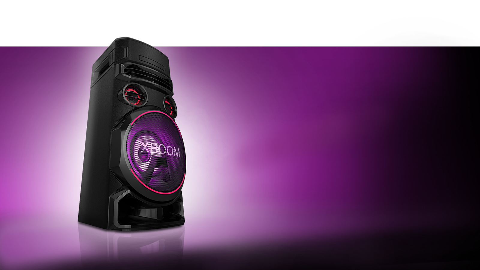 A low angle view of the left side of LG XBOOM against a purple background.  The XBOOM light are also purple.