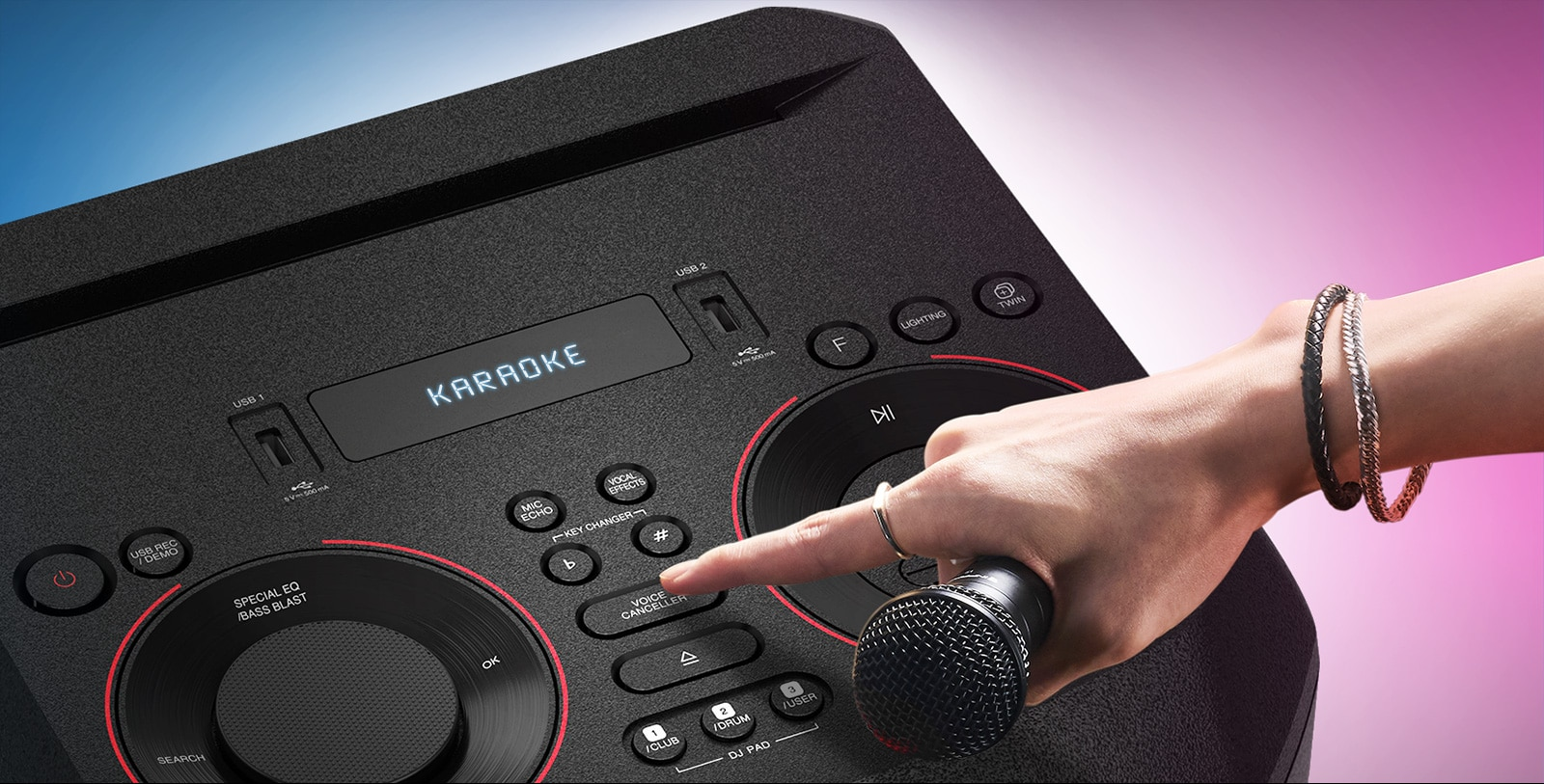 A hand holding a microphone tries to press the Voice canceller button on the top of LG XBOOM.