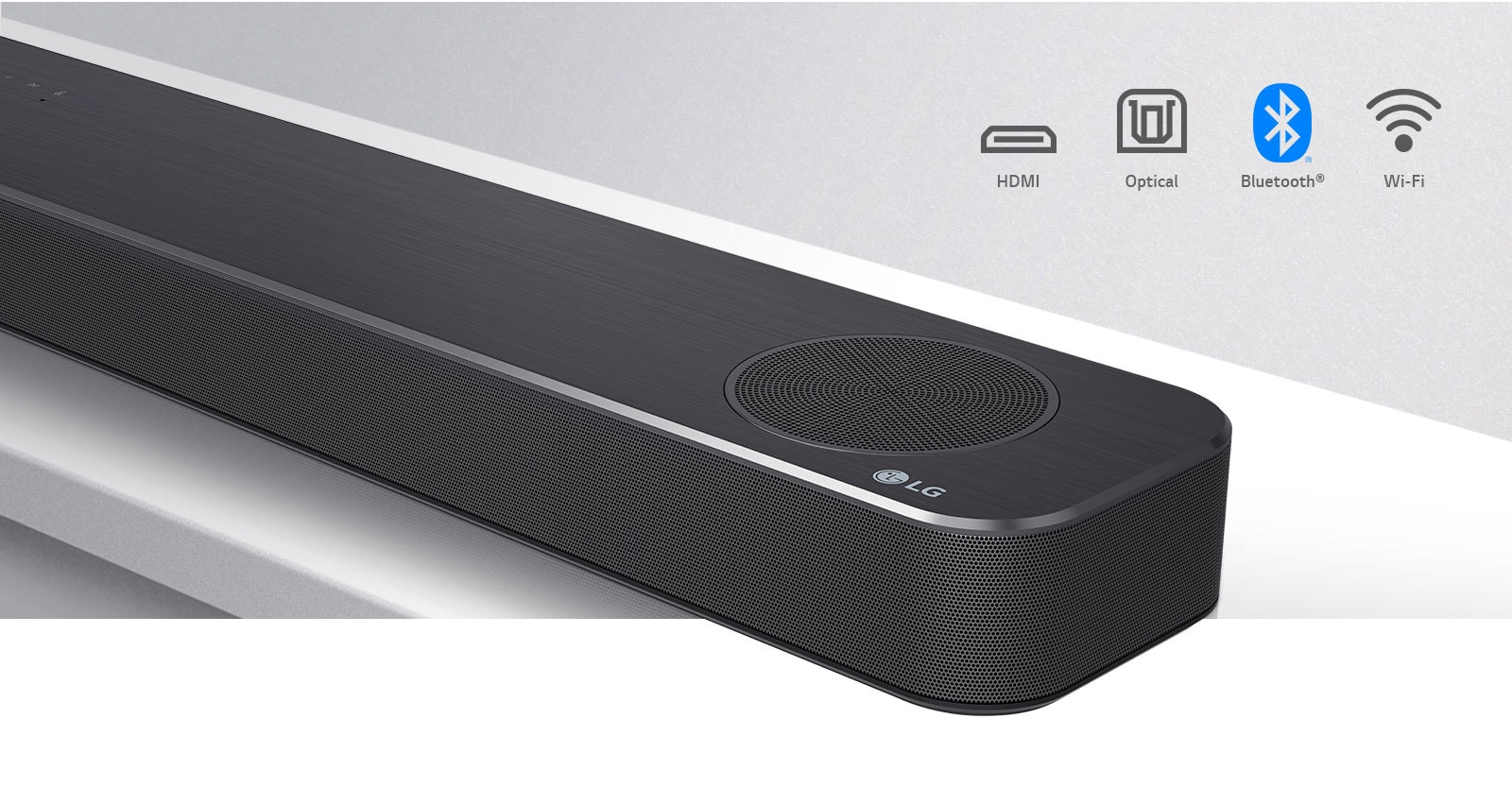 Close-up LG Soundbar right side with LG logo on the bottom right corner. Connectivity icons shown above the product.