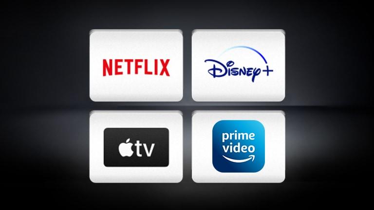 Het Netflix-logo, het Disney+-logo, het Apple TV-logo en Amazon Prime Video zijn horizontaal gerangschikt op de zwarte achtergrond.