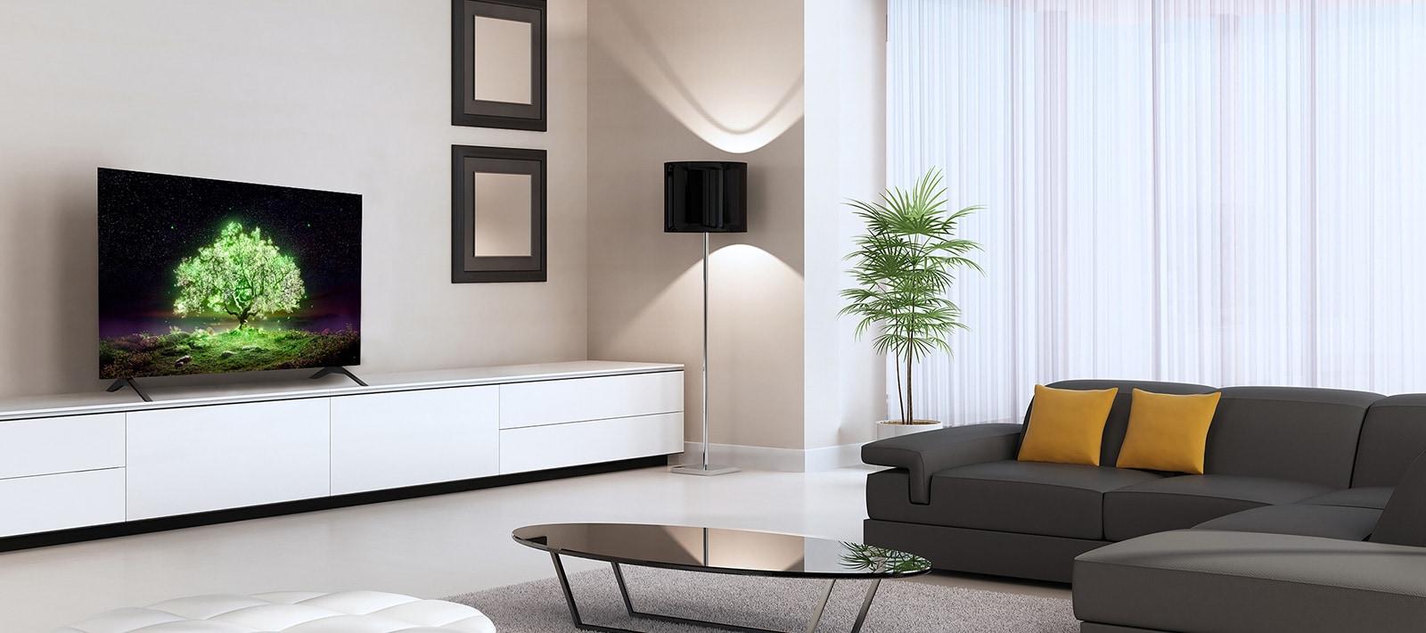 Telewizor OLED A1 w zmysłowo urządzonym pokoju. Na ekranie telewizora widać jasno świecące zielone drzewo.