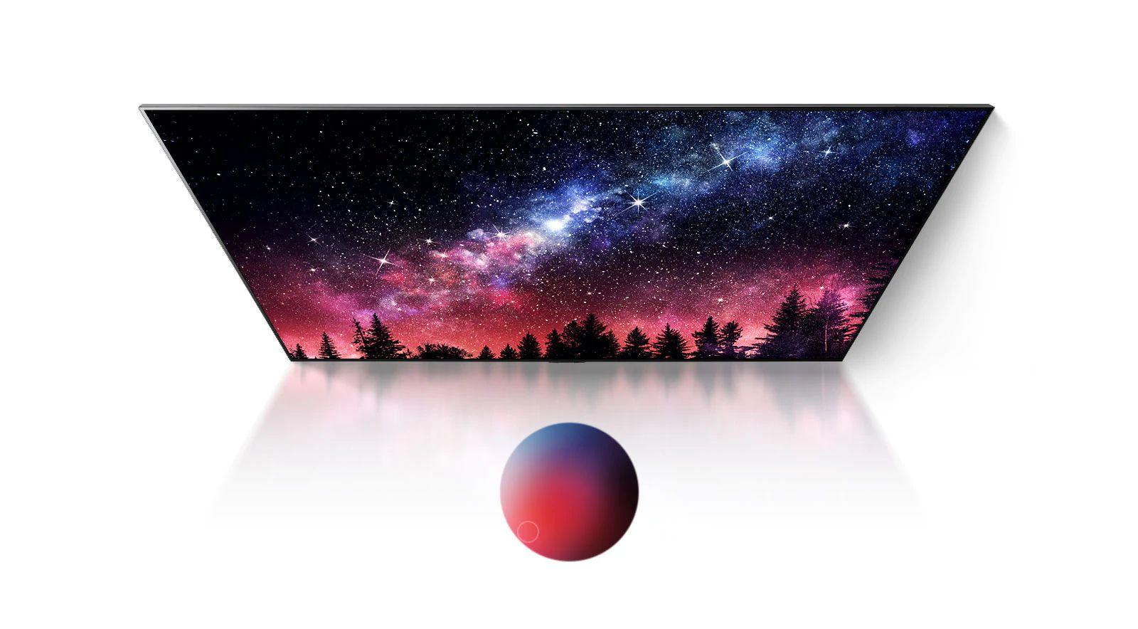 Ekran telewizora przedstawiający drogę mleczną, niebieskie niebo i eksplozję kolorowego pyłu w doskonałej jakości (odtwórz film)