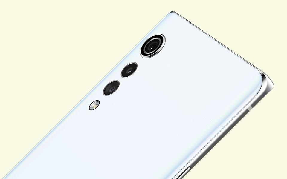 A rear view of the LG VELVET smartphone in Aurora White colour