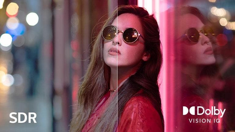 Сцена с женщиной в солнцезащитных очках, разделенная на две части для визуального сравнения. В нижней левой части изображения показан текст SDR, а в нижнем правом углу — логотип Dolby Vision IQ.