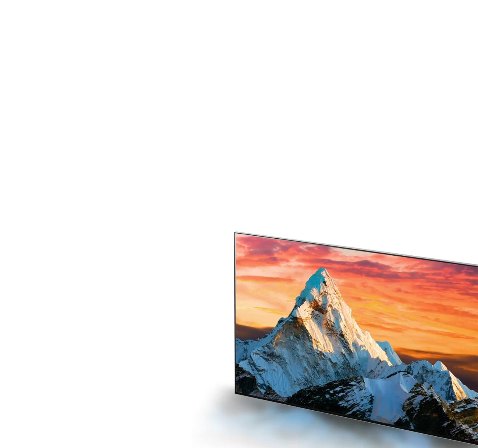 Экран телевизора, на котором показана гора на фоне оранжевого заката, по мере ее приближения детали становятся более четкими (воспроизвести видео).