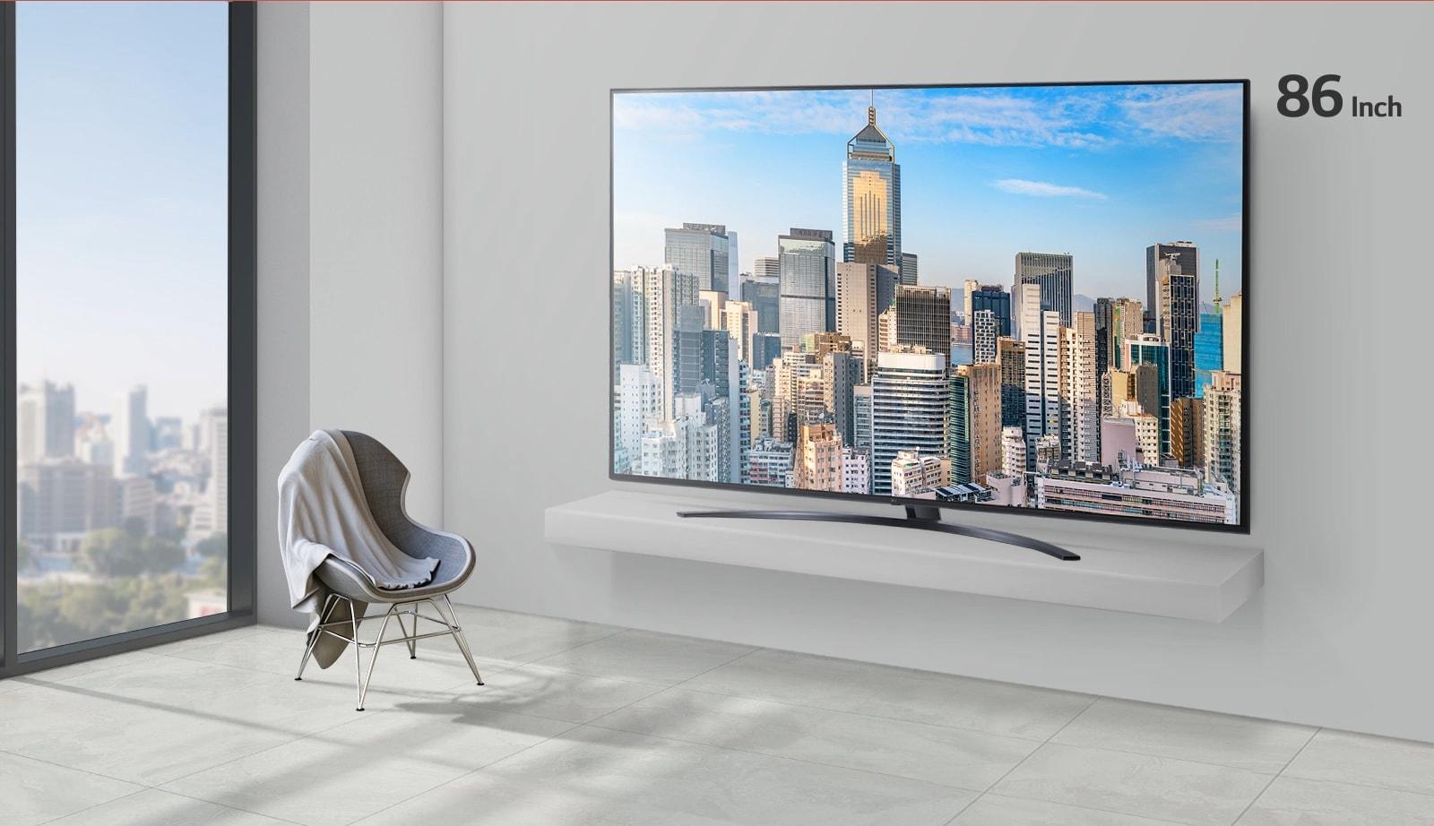 Размер телевизора с изображением небоскребов в офисе увеличивается с 55 дюймов до 86 дюймов