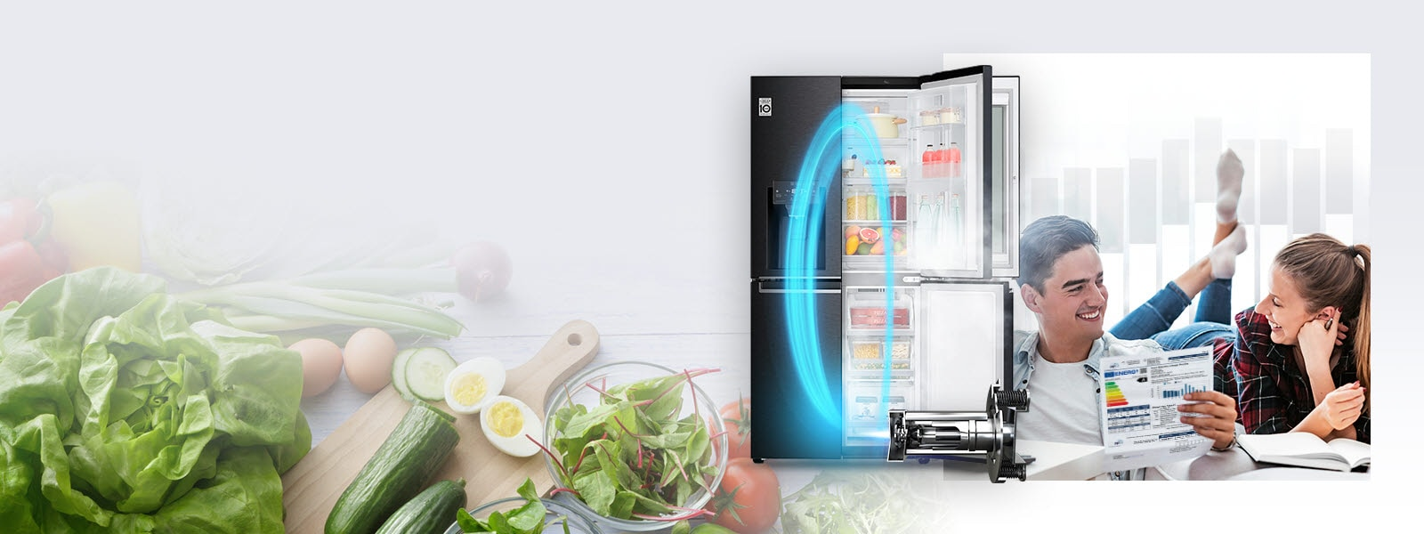An LG refrigerator with one side of doors open displaying produce and drinks inside is in the background along with a magnified image of fresh produce. Just in front of it is the LG Inverter Linear Compressor with a blue neon oval showing the energy from the machine in the refrigerator. Also in the image is a man and woman smiling at each other as the man holds an energy usage chart for the refrigerator.